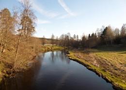 Naturliga svämningsängar längs med Ätran, söder om Dalums kyrka i Västra Götaland.